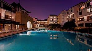 Indoor pool, outdoor pool, open 6 AM to 11 PM, pool umbrellas