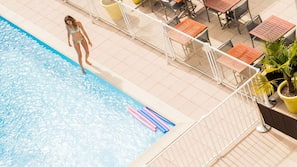 Seasonal outdoor pool, open 8:30 AM to 9:00 PM, pool loungers