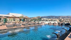 Outdoor pool, a heated pool, open 9:30 AM to 8:00 PM, pool umbrellas
