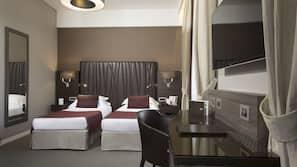 Premium bedding, memory-foam beds, free minibar, in-room safe