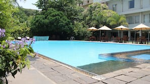 Outdoor pool, open 6:00 AM to 7:00 PM, pool umbrellas, sun loungers