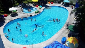 Seasonal outdoor pool, open 9 AM to 6 PM, pool umbrellas