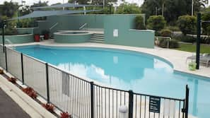Outdoor pool, open 7:00 AM to 9:00 PM, pool loungers