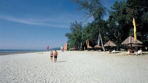 On the beach, free beach cabanas, sun-loungers, beach towels