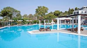 Seasonal outdoor pool, open 10 AM to 7:00 PM, pool umbrellas