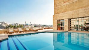 Indoor pool, seasonal outdoor pool, open open 24 hours, pool umbrellas
