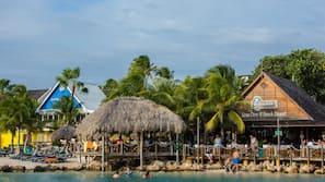 On the beach, free beach cabanas, beach towels, beach massages