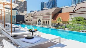 Outdoor pool, open 6:00 AM to 7:30 PM, pool umbrellas, pool loungers