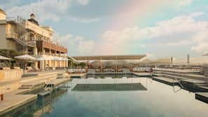 Outdoor pool, open 7:00 AM to 7:00 PM, pool umbrellas, pool loungers