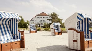 Free beach cabanas, beach towels, windsurfing, beach volleyball