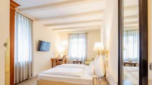 Luxe beddengoed, een minibar, een kluis op de kamer