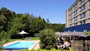 Seasonal outdoor pool, open 8:00 AM to 8:30 PM, pool loungers