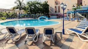Outdoor pool, open 10 AM to 6 PM, pool umbrellas