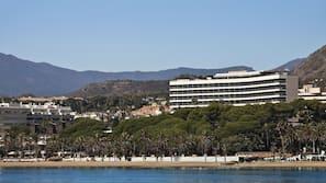 On the beach, beach cabanas, sun-loungers, beach bar