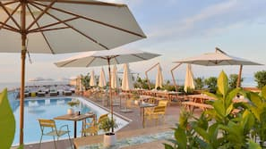 Seasonal outdoor pool, open 9 AM to 6 PM, pool umbrellas, pool loungers
