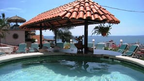 2 outdoor pools, open 9 AM to 11 PM, pool umbrellas, sun loungers