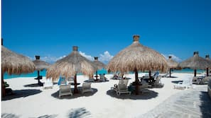 On the beach, white sand, free beach cabanas, sun loungers