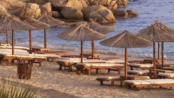 Een gratis shuttleservice van/naar het strand, strandlakens