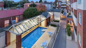 Outdoor pool, open 9:00 AM to 8:00 PM, pool loungers