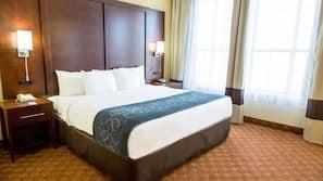 Premium bedding, memory foam beds, desk, laptop workspace