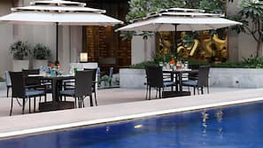 Outdoor pool, open 6:30 AM to 10:00 PM, pool umbrellas, pool loungers