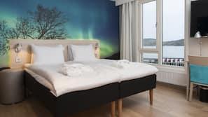 Luxe beddengoed, pillowtop-bedden, een minibar, een bureau