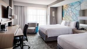 Hypo-allergenic bedding, pillowtop beds, desk, laptop workspace
