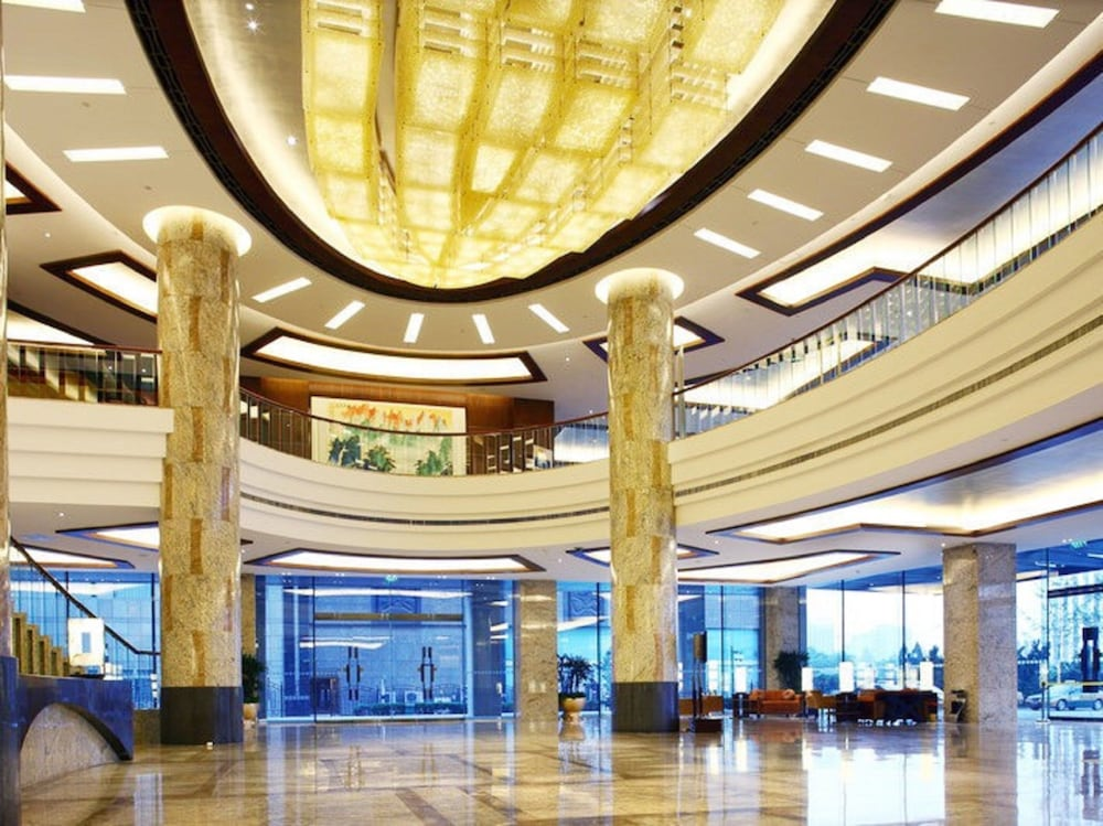 Beijing International Hotel 4 5 Out Of 0 Street View Featured Image Interior Entrance