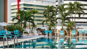 Outdoor pool, open 7 AM to 7 PM, pool umbrellas, sun loungers