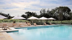 7 outdoor pools, pool umbrellas, pool loungers