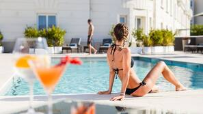 Outdoor pool, open 10:00 AM to 8:00 PM, pool umbrellas, sun loungers