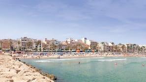 On the beach, beach towels