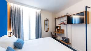 Premium bedding, pillow-top beds, desk, laptop workspace