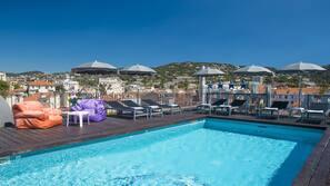 Seasonal outdoor pool, open 9:00 AM to 8:00 PM, free pool cabanas