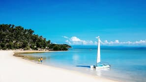 Private beach, beach towels, beach massages, scuba diving