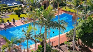Outdoor pool, open 7 AM to 5:00 PM, pool umbrellas, pool loungers