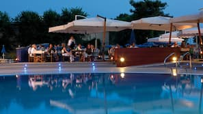 2 outdoor pools, open 9:30 AM to 7 PM, pool umbrellas, pool loungers