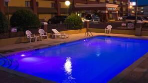 Seasonal outdoor pool, open 9:00 AM to 10:00 PM, sun loungers