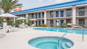 Outdoor pool, open 10:00 AM to 10:00 PM, pool umbrellas