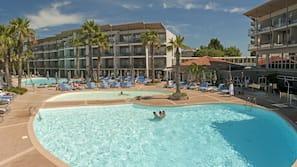 Indoor pool, 2 outdoor pools, open 9 AM to 7:00 PM, pool umbrellas