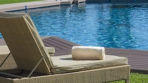 Seasonal outdoor pool, open 10:00 AM to 6:00 PM, pool umbrellas