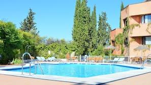 Seasonal outdoor pool, open 11 AM to 8 PM, pool umbrellas, pool loungers