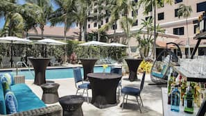 Outdoor pool, open 6:00 AM to 11:00 PM, free cabanas, pool umbrellas