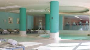 Indoor pool, open 8:00 AM to 11:00 PM, pool loungers
