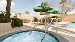 Outdoor pool, open 8:00 AM to 10:00 PM, sun loungers