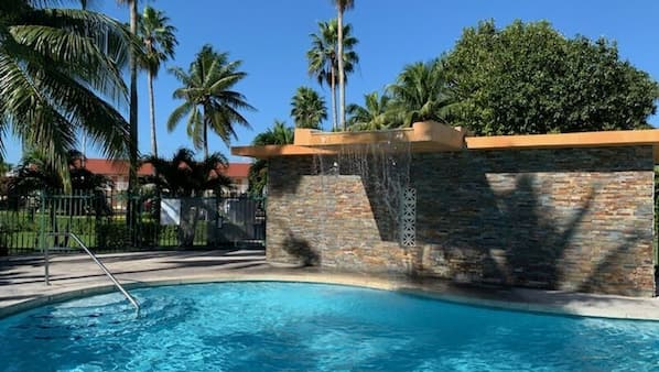 Outdoor pool, open 8:00 AM to 8:00 PM, pool loungers