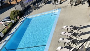 Seasonal outdoor pool, open 9 AM to 9 PM, pool umbrellas