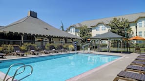 Seasonal outdoor pool, open 7 AM to 10 PM, pool loungers