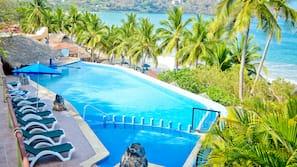 Seasonal outdoor pool, open 8:30 AM to 10:30 PM, pool umbrellas