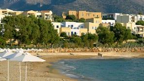 On the beach, sun-loungers, beach umbrellas, waterskiing
